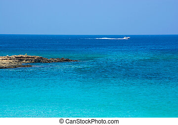 Sea coast, rocky bay in a quiet sunny day. Mediterranean...
