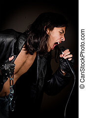 Heavy metal - Rock singer with metal chain jewelry singing...