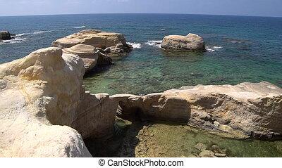 White beach. Mediterranean Sea. Sea landscape of Cyprus with a rocky shore.