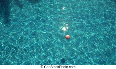 Beach ball floating in pool - Beach ball floating in the...