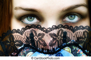 Hypnotic eyes - Mysterious woman with intense green eyes
