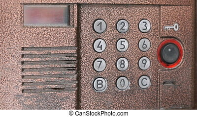 Person opening door using a numeric code of access - The...