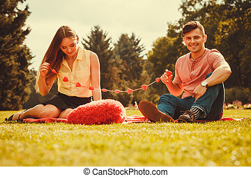 Enamoured couple in park. - Love romance relationship dating...