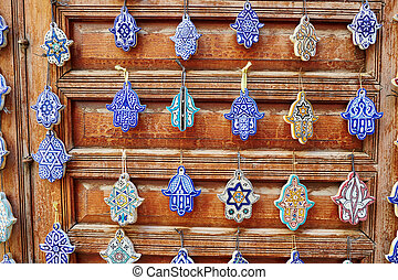 Selection of traditional Moroccan amulets, khamsa, providing...