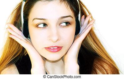 Beautiful girl listening music at headphones - Beautiful...