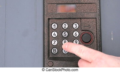 Person push buttons on a panel of intercom system