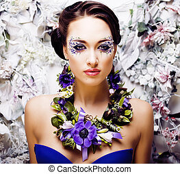 floral face art with anemone in jewelry, sensual young...