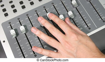 Sound Designer Mixing Console Faders - Sound designer mixing...