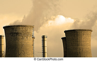 Two industrial towers releasing toxic gas in the air -...