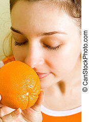 Orange fragrance - Healthy woman fascinated by fragrance of...