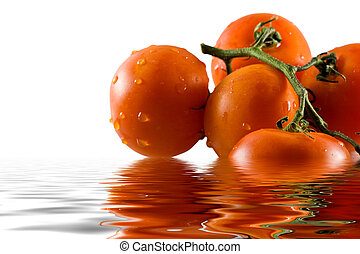 Bunch of tomatoes reflecting in water