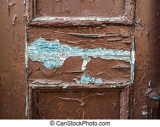 old brown door - A very worn and battered old brown door