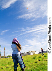 Girls playing with kite