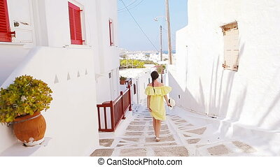 Beautiful woman outdoors in old streets an Mykonos. - Girl...