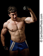 Strong! - Muscular handsome man showing his force