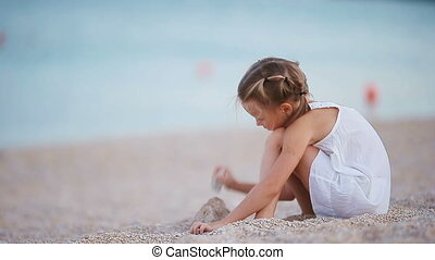 Adorable little girl playing on the beach - Adorable little...