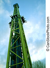 People experimenting strong sensations at amusement park -...