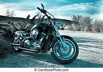 Black chopper in nature - View of black powerful chopper in...