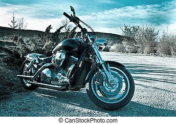 Black chopper in nature - View of black powerful chopper in...