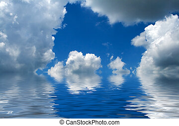 Blue cloudy sky reflecting in water