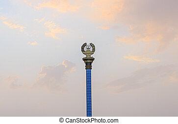 Emblem of Tajikistan on the stele. Dushanbe