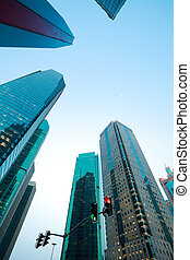 Looking up at Shanghai modern city buildings backgrounds