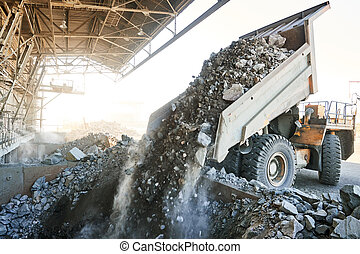 dumper truck unloading granite or ore into sorting plant