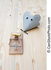 Mousetrap - Mouse made of paper and mousetrap with bacon on...