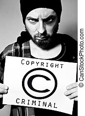 Copyright criminal - Man arrested for violating copyright...