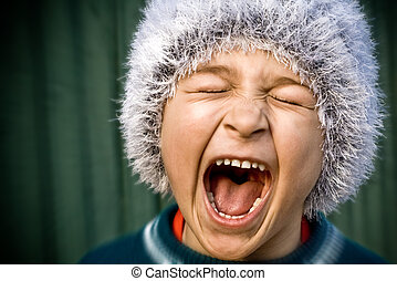 Crazy kid screaming loudly - Close-up of portrait of crazy...