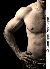 Muscular guy on black background - Close-up on muscular man...