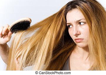 joven, mujer, enredado, pelo