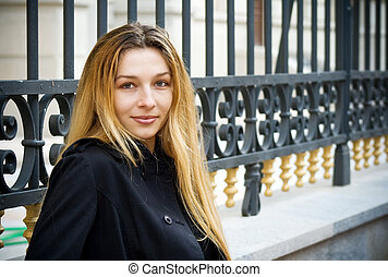 Smiling young woman in the city - Portrait of smiling young...