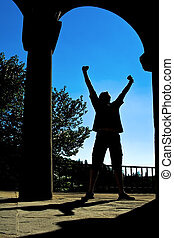 Man silhouette expressing victory - Success concept - man...