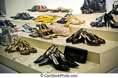 Shopping - Many shoes and purses on store showcase