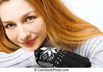 Winter time - Close-up portrait of beautiful woman dressed...