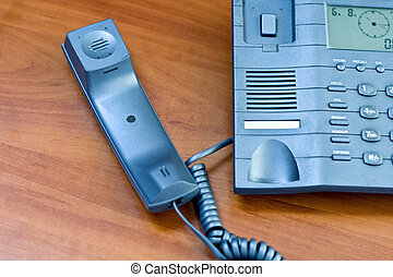 Telephone with receiver put aside