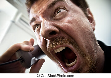 Man shouting at telephone - Extreme angry man shouting at...