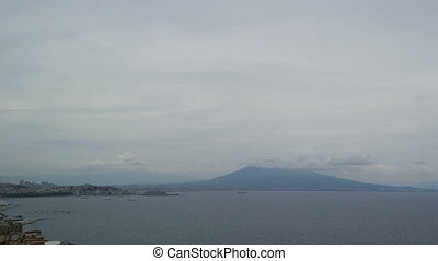 Vesuvius Volcano in the clouds hat in the Bay of Naples