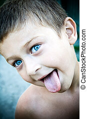 Cute kid sticking his tongue out