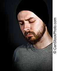 Melancholic man - Low-key portrait of melancholic handsome...