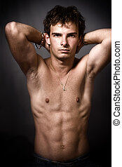 Athletic man with fine muscular abdomen - Athletic man...