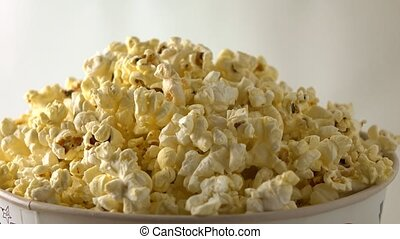 Rotating paper box of popcorn. 4K clip - Rotating paper box...