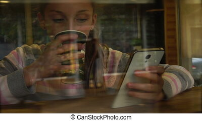Teen young watching on her smartphone and surfing in...