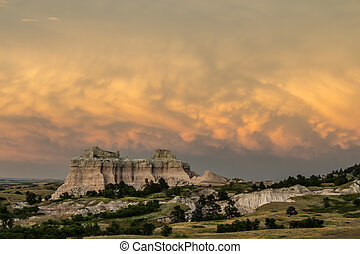 Badlands stormy sunset - A distant storm over the badlands...