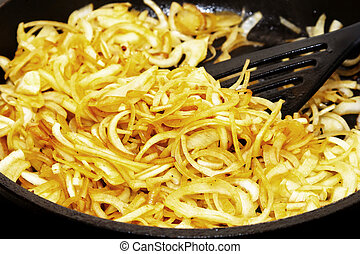Fried onion in a frying pan - Fried onion in the frying pan...