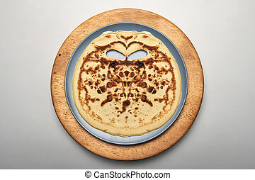 I see face on a pancake - Face on a pancake for Halloween