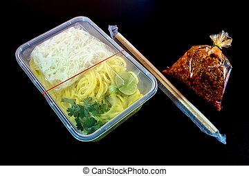 Spaghetti with sauce Take home food in plastic packaging