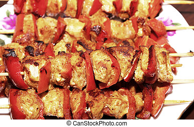 Chicken and vegetable kabobs. - Vegetable and chicken meat...