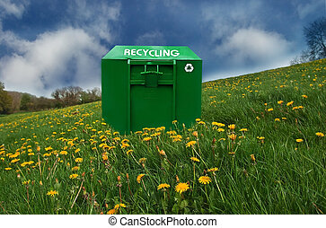 Recycling bin in a dandelion covered meadow.